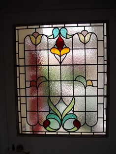 How about putting the stained glass in the door between hallway and back room. That way we preserve the glass homogeny with back door and front door.