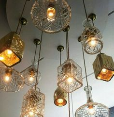Vintage lampshades made from cut glass decanters.