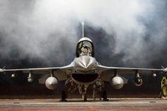 Lt. Col. Mark Sletten, an F-35 Lightning II program-integration officer, lowers…