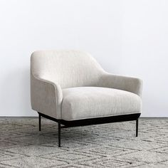 Design by 365º North The Chill Low Back Chair in washed grey fabric is inspired by a pure and minimalistic approach to lounge chair designs. Its internal struct
