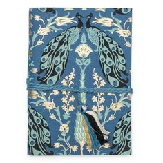Fauna Journal - Blue Peacock - Matr Boomie (J) Softbound eco-friendly paper 5 by 7 inch journal with fauna inspired design, blue with a peacock scene. Dori tie and tassel closure.