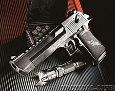 Mark XIX Magnum Research Desert Eagle .50 Caliber Pistol (and a box of Speer 325-grain .50 AE ammo): Made entirely now in the U.S... this handgun also switches from .50 Cal to .44 Mag by simply changing barrels & magazines (the CorBon .440 requires separate chambering)... I fired the old version of the Desert Eagle at an indoor firing range in Israel just after Desert Storm... a .50 Cal handgun has plenty of kick...