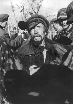 Waffen SS search terrified Russian civilians caught near Demyansk, Sept 20, 1941.
