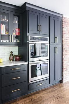 White Shaker cabinets with white countertops and black pantry. White Shaker cabinets with white countertops and black pantry. - Own Kitchen Pantry Kitchen Pantry Design, Kitchen Pantry Cabinets, Home Decor Kitchen, Diy Kitchen, Kitchen Interior, Kitchen Ideas, Kitchen Organization, Kitchen Designs, Kitchen Counters
