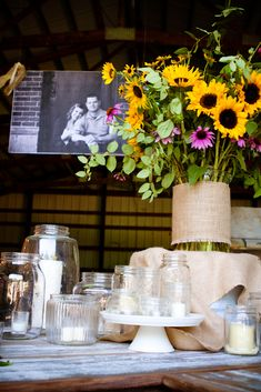 mason jars, burlap, and wildflowers. add some lace over the burlap? .....actually, EVERYTHING about this would be perfect for a wedding