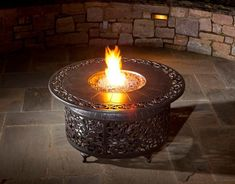 This cast aluminum gas fire pit patio table is great for adding to any patio chat set. The Alfresco Home Bellagio 48 inch fire pit chat table includes blue luster fire glass beads and features a base that allows you to hide the propane tank.