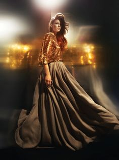 Glitzy, large long skirt reflects the hair, she's brunette! Just beautiful!