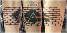 Pink Floyd the wall, The wall tattoo with Pink Floyd theme plus graffiti shown in this snap is more ornate and covers the entire calf muscle. The larger it is the better the design looks.
