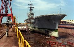 USS Inchon, LPH-10, in drydock, Feb 1991 after for repairs after distinguished a cave in a Persian Gulf. Ironically she was carrying HM-14 H...