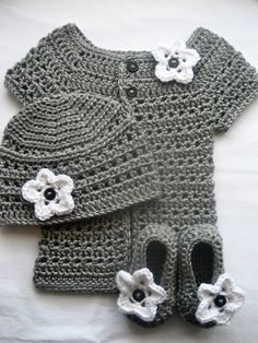 Matching gray cardigan, beanie, and booties with bright white flower embellishments.