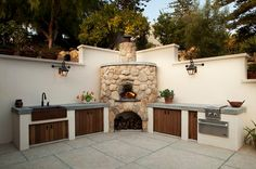 Outdoor kitchens are quite common as part of traditional houses' designs. They're basically an extension of the interior living spaces and a wonderful plac