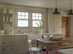Old farmhouse kitchen renovation, traditional cabinetry, farm table, vintage pendant lights, country house, open shelving, farmhouse sink - Rafe Churchill: Traditional Houses