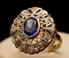 Anel em 2 tons de ouro 18 kts com pedra na cor azul e brilhantes, aro 14 - PT 5.5 grs