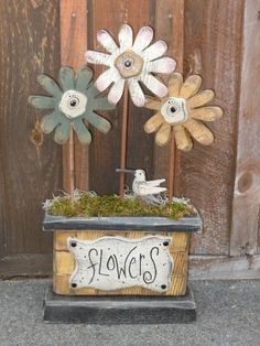 Wood flowers....love the soft primitive colors