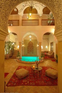 Moroccan living room and atrium. I wish. Lol. My living room will never have a pool in it. Just not sensible.