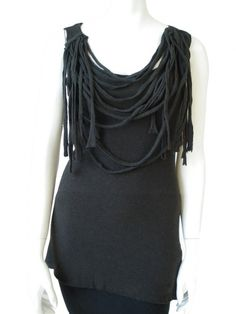 Norio Nakanishi's Sleeveless tunic, elasticated, motif of free laces on the neckline. Price: $103.00