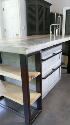 4x8 kitchen island, silver maple and concrete counter. Concrete sink with hickory legs.