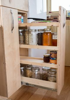 Plenty of room: In the kitchen, Greg designed a pantry with pull out shelves for canned fo...