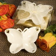 Porcelain Butterfly Wedding Favors - Of these would be fun to get a little bigger and do as food trays. Or on the cake table as with Mints and Peanuts in them.