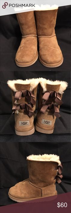Size 4y/5.5w Ugg bow bailey boots Cute size 4y/5.5w Ugg bailey now boots in chestnut, authentic and clean, excellent condition and gently used. UGG Shoes