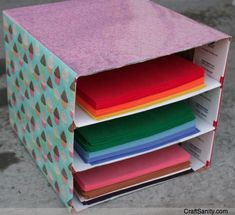 Make a construction paper organizer with ceral or diaper box.    DIY Organizing Tips Using Recycled Containers