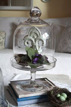 Fleur de lis figurine under a bell jar/cloche