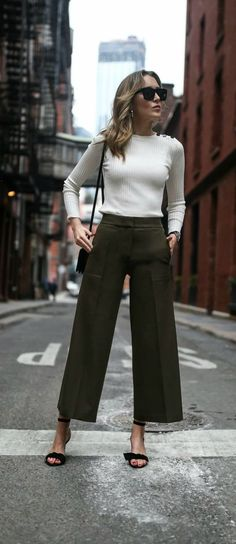 2018 trends: wide leg cropped olive pants, classic ivory ribbed light sweater with button shoulder detail, tie ankle strap heeled sandals