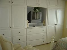 bedroom #3 with built in cabinets and TV