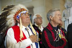 Native American code talkers stand during a ceremony in which they received the Congressional Gold Medal in Emancipation Hall at the Capitol in Washington, D.C., Nov. 20, 2013. The U.S. Congress awarded the medal as an expression of the nation's profound gratitude to the code talkers for their valor and dedication during World War I and World War II. SHIT!!!!WHAT TOOK SO LONG!!!!!