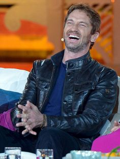 Love his laugh! The Hollywood heartthrob looked good in his black leather jacket and blue jumper on Wetten Dass