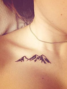 The good thing about mountain tattoos is that you can create one in any size. This one shows a little mountain range near the collarbone. Just a message showing you are strong.