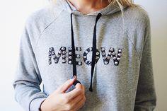 http://thebandwifeblog.com/2013/10/29/meow-studded-cat-sweatshirt-diy/