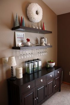 i LOVE the idea of shelves over the buffet... sweet idea with the wine glasses.. AND l love those trees!