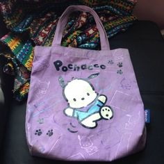 KAWAII/ANIME Tote ^.^ This Japanese bag it totally adorable! Perfect for carrying around school supplies and books or just as a purse. I bought this at an Asian/Anime shop. The character Pochacco is from the Hello Kitty Collection. Hello Kitty Bags Totes