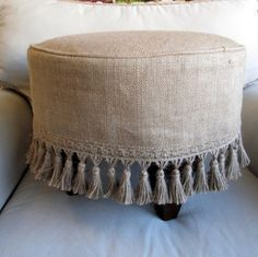PLEASE ALLOW 7 10 DAYS TO SHIP THIS ITEM IS MADE TO ORDER made entirely by me round stool finished in off whte ticking and slipcovered in burlap with burlap tassel fringe dark wood legs in a square style round top overall size top to Burlap Projects, Burlap Crafts, Round Stool, Banquette, Diy Furniture, Decoration, Upholstery, Burlap Ottoman, Ottoman Slipcover