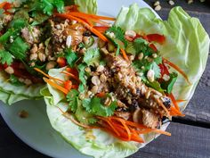 Barbells and Bellinis: Thai Chicken Tacos (orange juice, soy sauce, honey, grated ginger, lime, red pepper flakes || peanut butter, sesame oil || shredded carrots, red peppers, chicken, cilantro, peanuts, lime wedges, sriracha sauce)