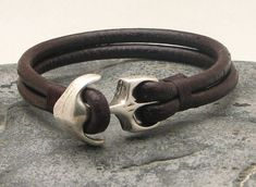 FREE SHIPPING Men's leather bracelet Brown leather muti strap leather bracelet with silver plated anchor clasp. $23.00, via Etsy. - yes, this is a men's bracelet. yes, i am not a man. yes, i still want it.