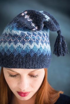 This jaunty Fair Isle hat - easy to work in the round from the brim up- is knit in Rowan's Felted Tweed. The top decreases down to 12 stitches; the yarn is pulled through and the tassel is added.