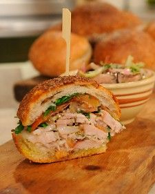 Pile porchetta slices high on a crusty roll for a traditional Italian lunch. This recipe comes from chef Justin Smillie.