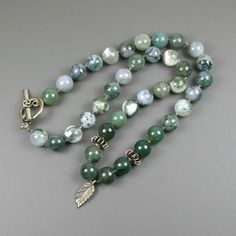 Moss agate stone strand necklace with Hill Tribes fine silver roundels and leaf charm on knotted cord from the Earthwear Collection
