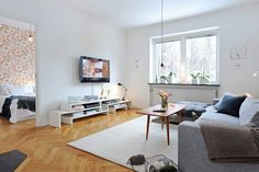 The living room is the place that features the gem of the apartment – the fireplace.