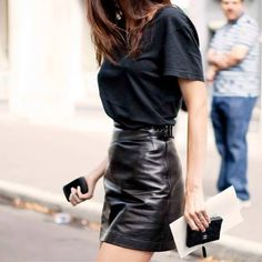 Leather skirt and over sized t-shirt.
