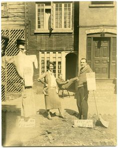 Edna St. Vincent Millay and husband Eugen Jan Boissevain in front of house at 75-1/2 Bedford Street, New York