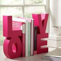 Paint and glue together block letters, use for book ends