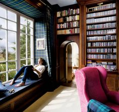 home library with a bay window, curved doorway.