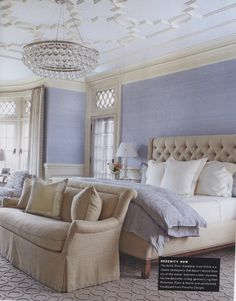 Chandelier in room with lower ceilings, ceiling moulding, settee at foot of bed