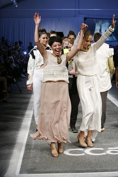 Elated Fashion Design student Lauren Levin on the runway with model during CCA Annual Fashion Show 2012 Finale