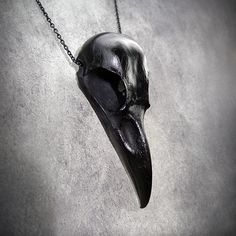 Hey, I found this really awesome Etsy listing at http://www.etsy.com/listing/106651253/black-raven-skull-cast-bone-resin