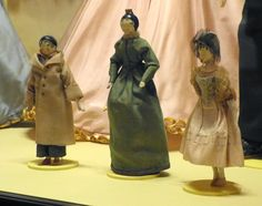 Queen Victoria's home-made wooden dolls There was also a beautiful dress from about 1830 which had been worn by Princess Victoria as a girl and three wooden dolls which she had played with.