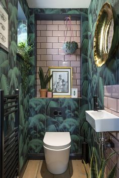 green bathroom A tropical theme can be found in this downstairs cloakroom, which is a haven of a designer-favourite colour combination pink and green. Small Downstairs Toilet, Small Toilet Room, Downstairs Cloakroom, Small Bathroom, Bathrooms, Tropical Bathroom Decor, Bathroom Ideas, Cloakroom Ideas, Bathroom Green